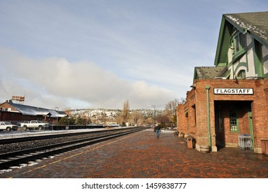 FLAGSTAFF, AZ / USA - DECEMBER 17 2010:  The brick platform and steel tracks at Flagstaff Amtrak station on Route 66 in downtown Flagstaff. The sign for Motel DuBeau is across the tracks.