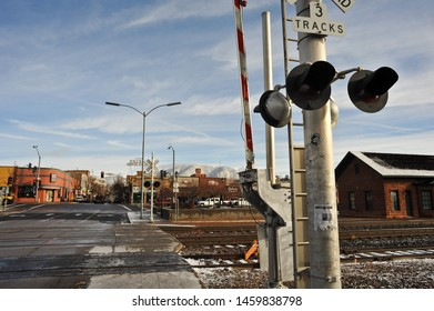 FLAGSTAFF, AZ / USA - DECEMBER 17 2010:  The gate, warning lights and train tracks at the railroad crossing at S San Francisco near Route 66 in downtown Flagstaff.