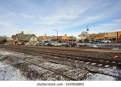 FLAGSTAFF, AZ / USA - DECEMBER 17 2010:  Railroad tracks run parallel to Route 66 in downtown Flagstaff. The Amtrak station and storefronts on Route 66 are visible on the