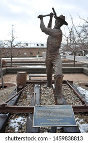 "FLAGSTAFF, AZ / USA - DECEMBER 17 2010:  ""The Gandy Dancer"", a monument to the section hands who built the railroad, was made by Clyde ""Ross"" Morgan in 2000, near the Flagstaff train station."