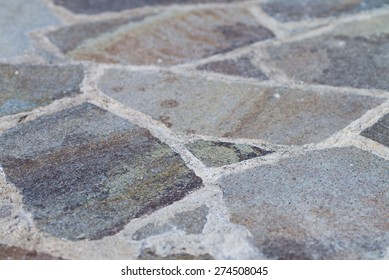 A Flagstone Patio shot at an angle fading into a blurred background.