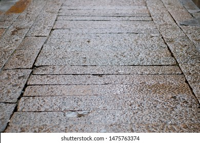flagstone road of Chinese old town with rain water. perspective