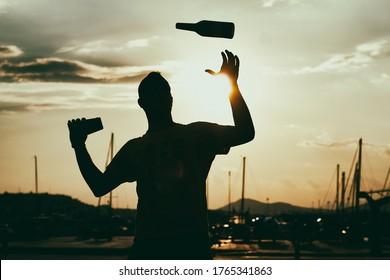 Flair bartender against the sunset