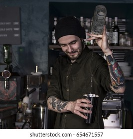 Flair smiling bartender in action