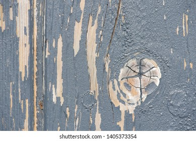 Flaking paint: gray paint flaking off a wood substrate