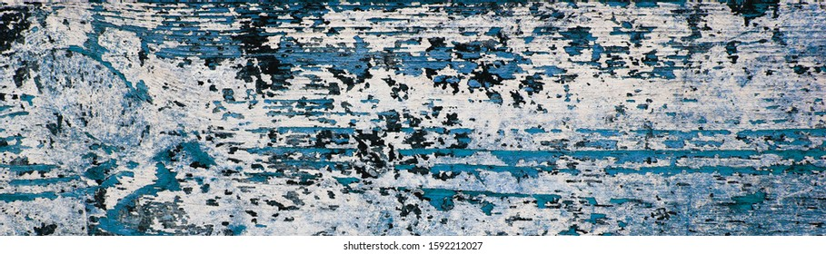 Flaking & peeling paint on rustic wood in panorama - shabby chic, retro or vintage background texture for your design.