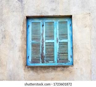 Flaky Blue Shutters on a quiet Greek sidestreet