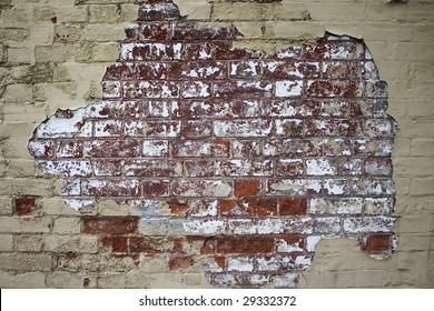 Flaky paint, old brick wall.