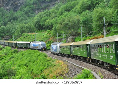 Flam, Norway, 18.06.2018, Two trains passing on the Flam Railway (Flåmsbana), a scenic railway which runs betwen Flåm and Myrdal, Aurland, Sogn og Fjordane, Norway