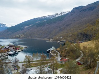 Flam, Norway - Apr 20th, 2019: Tourist visit Flam by ferry boat. Flam is a village in southwestern Norway, in an area known for its fjords. It sits at the end of Aurlandsfjord,  vast Sognefjord
