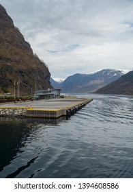 Flam, Norway - Apr 20th, 2019: Ferry port at Flam. Flam is a village in southwestern Norway, in an area known for its fjords. It sits at the end of Aurlandsfjord, a branch of the vast Sognefjord