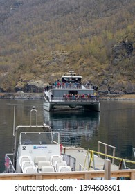 Flam, Norway - Apr 20th, 2019: Tourist visit Flam by ferry boat. Flam is a village in southwestern Norway, in an area known for its fjords. It sits at the end of Aurlandsfjord.