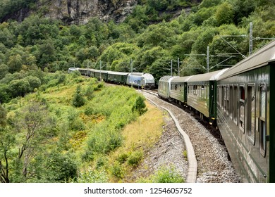 FLAM, NORWAY - AUGUST 14, 2016: Famous Flamsbana railroad track and train waiting for the opposite one in Norway connecting Flam city and Myrdal station with beautiful views on the Norwegian landscape