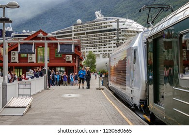 """FLAM, NORWAY- AUGUST 9, 2018 : People coming from the cruise ship that entered the Sognefjord in Flam. These tourists will take the famous """"Flambana"""" to enjoy a day of fantastic Norwegian nature."""