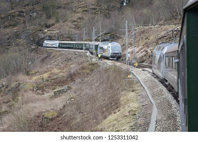 FLAM, NORWAY - CIRCA MAY 2018: two railway trains traveling towards each other on the Norwegian, high mountain railway between Myrdal and Flam.