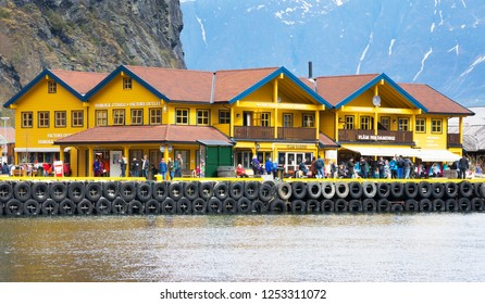 FLAM, NORWAY - CIRCA MAY 2018:  travel and tourism vacation and  Mountains landscape the Norwegian city of Flam. Yellow buildings on the shore on fjord Sognefjord.