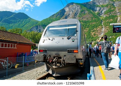 FLAM, NORWAY - JULY 16, 2018: Breathtaking Norwegian fjord and mountain landscapes during The Flam Railway (Flamsbana) trip Myrdal - Flam on Norway in a Nutshell Tour. The Flamsbana Railway in Flam.