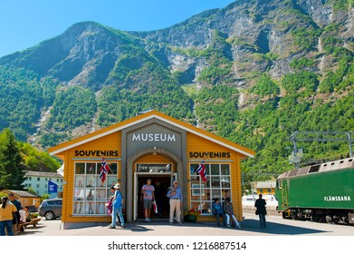 FLAM, NORWAY - JULY 16, 2018: Breathtaking Norwegian fjord and mountain landscapes on Norway in a Nutshell Tour. The Flam Railway Museum and The Flam Railway (Flamsbana) locomotive in Flam.