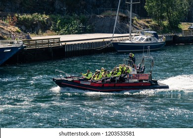 Flam, Norway - July 2018: Tourists on a Aurlandsfjord fjord safari tour in the Flam harbor on a RIB boat