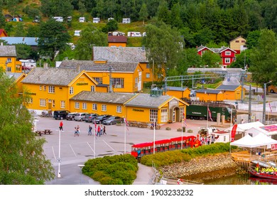 Flam, Norway - July 31, 2018: High angle town summer view, train station with Flamsbana train and museum