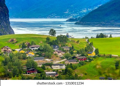 Flam, Norway, norwegian fjord village with Sognefjord landscape and cruise ship