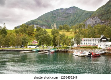 Flam, Norway-August 16, 2014 -  People and touristic buses in Flam village port.
