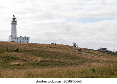 FLAMBOROUGH HEAD, YORKSHIRE, UK - AUGUST 29, 2021:  Flamborough Head Lighthouse, first lit 1806, acts as a waypoint for passing deep sea vessels and coastal traffic between Scarborough and Bridlington