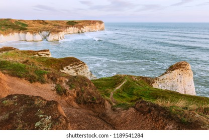 Flamborough, Yorkshire, UK. Environmental erosion along the chalk cliffs by sea, wind and weather viewed at dawn, Flamborough, Yorkshire, UK.