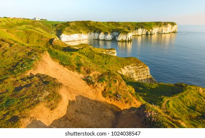 Flamborough, Yorkshire, UK. Eroded chalk cliffs along the North Sea coastline viewed for high position as dawn breaks at Flamborough, Yorkshire, UK.