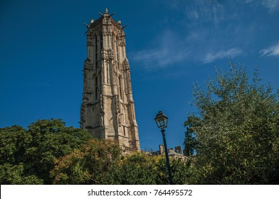 "Flamboyant Gothic Saint-Jacques Tower and blue sky in the City Center of Paris. Known as the ""City of Light"", is one of the most impressive world's cultural center. Northern France."