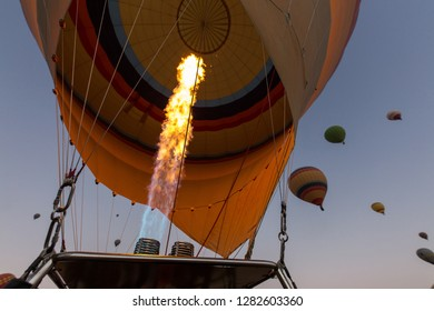 Flame in balloons. Flying with balloons over Cappadocia valleys, Turkey