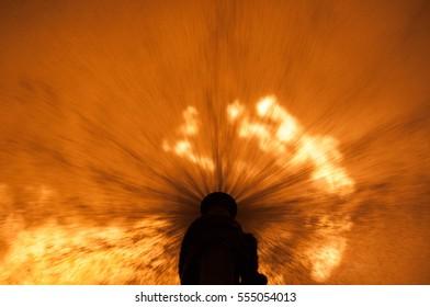 Flame behind water screen