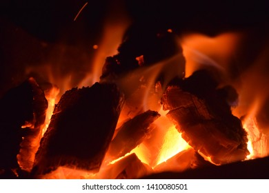 The flame burns the charcoal in the stove causing heat and lighting.