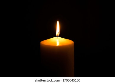 Flame candle isolated on black background. Close up.