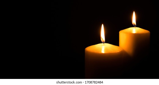 Flame candles isolated on black background. Close up. Copy space.