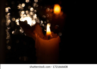 the flame of a church candle in a dark room close-up
