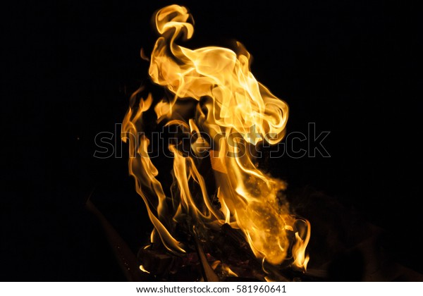 Flame explosion texture on black background