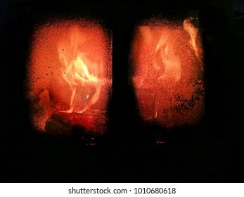 Flame in the fireplace, symbol of hell