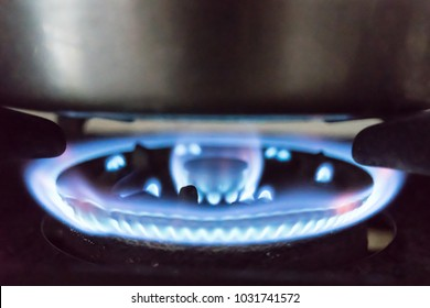 Flame from a gas stove The fire is blue under the boiler.