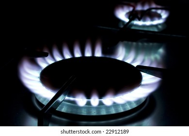 Flame on gas stove on dark background
