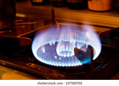 Flame on a gas stove in the kitchen.