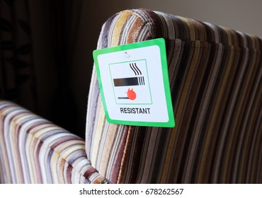 Flame resistant label attached to furniture