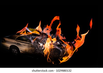 flame and smoke from burned crach model car paper shape in dark background with to warning in acidence concept