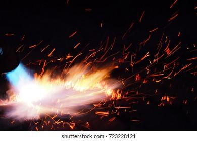 flame thrower, dark background fire