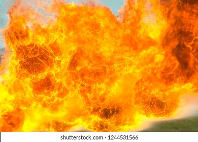 Flame tongues from the flamethrower. background of fire.