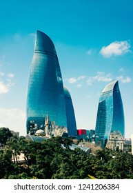 Flame towers and the minarets of the old mosque in Baku, Azerbaijan 13 april 2017