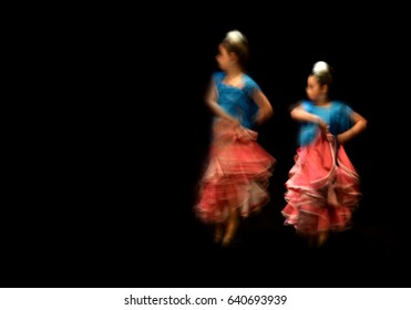 Flamenco dancer with motion blur effect. Typical regional dance from Spain, abstract composition.