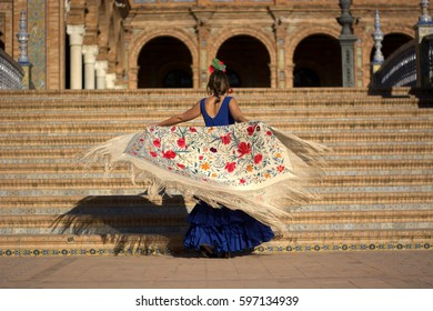 A flamenco dancer in the Plaza of Spain Seville