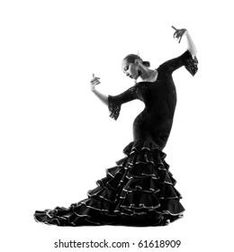 Flamenco dancer silhouette over white background