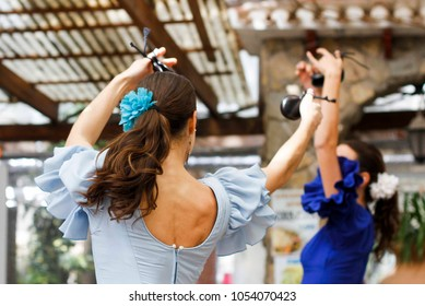Flamenco dancers in Spain with blue dress and castanets